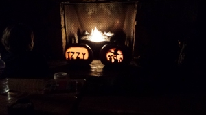 Jack-o-lantern with the fire on.  We used that fireplace a lot.
